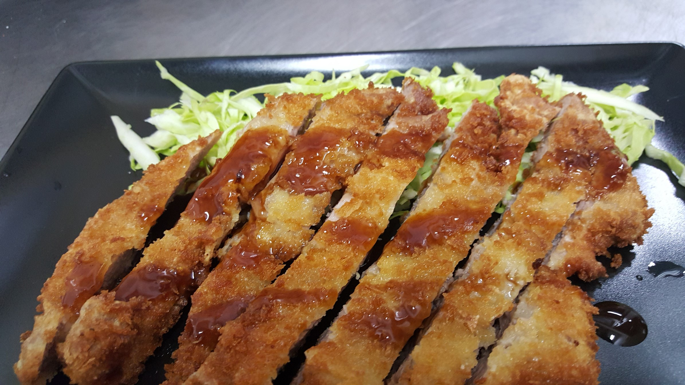 TONKATSU - pork bon fillet, deep fried in panko bread crumbs with Tonkatsu sauce