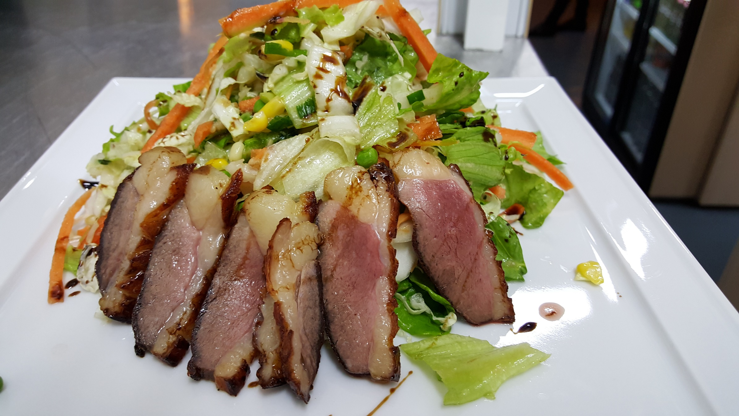 HOT ASIAN DUCK SALAD - salad mix, carrots, sprouts, sweet corn, duck magret poured with tamarind sauce and sliced almonds