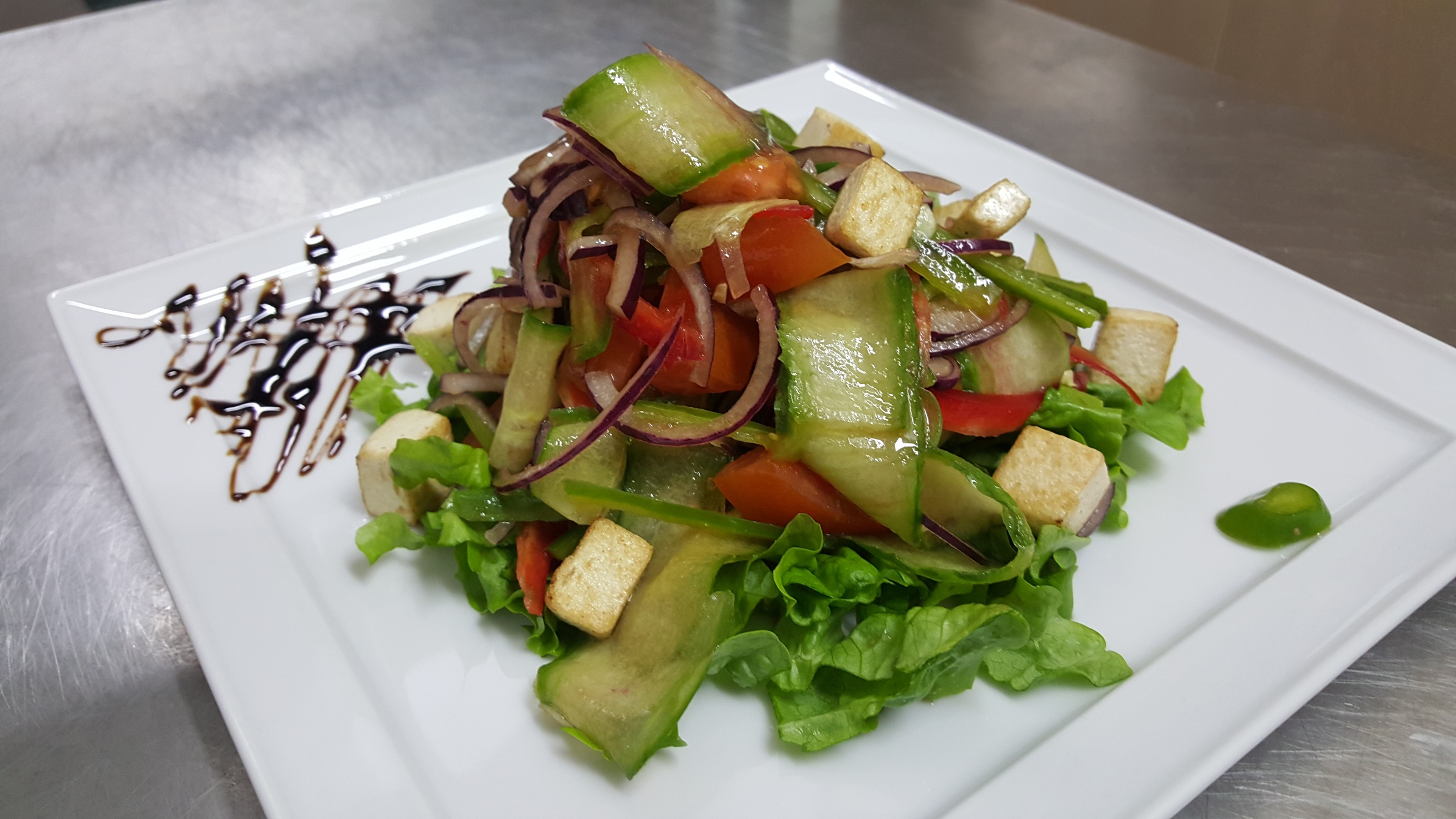 FRESH VEGETABLES WITH TOFU CHEESE - garden vegetables, red onion, tofu cheese, balsamic vinegar dressing, it may be served with firm bulgarian cheese