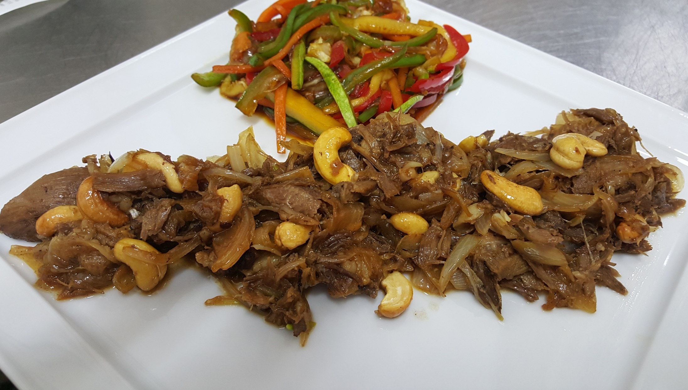 CASHEW FRIED DUCK - juicy duck thigh meat, prepared with onion, garlic and soya sauce