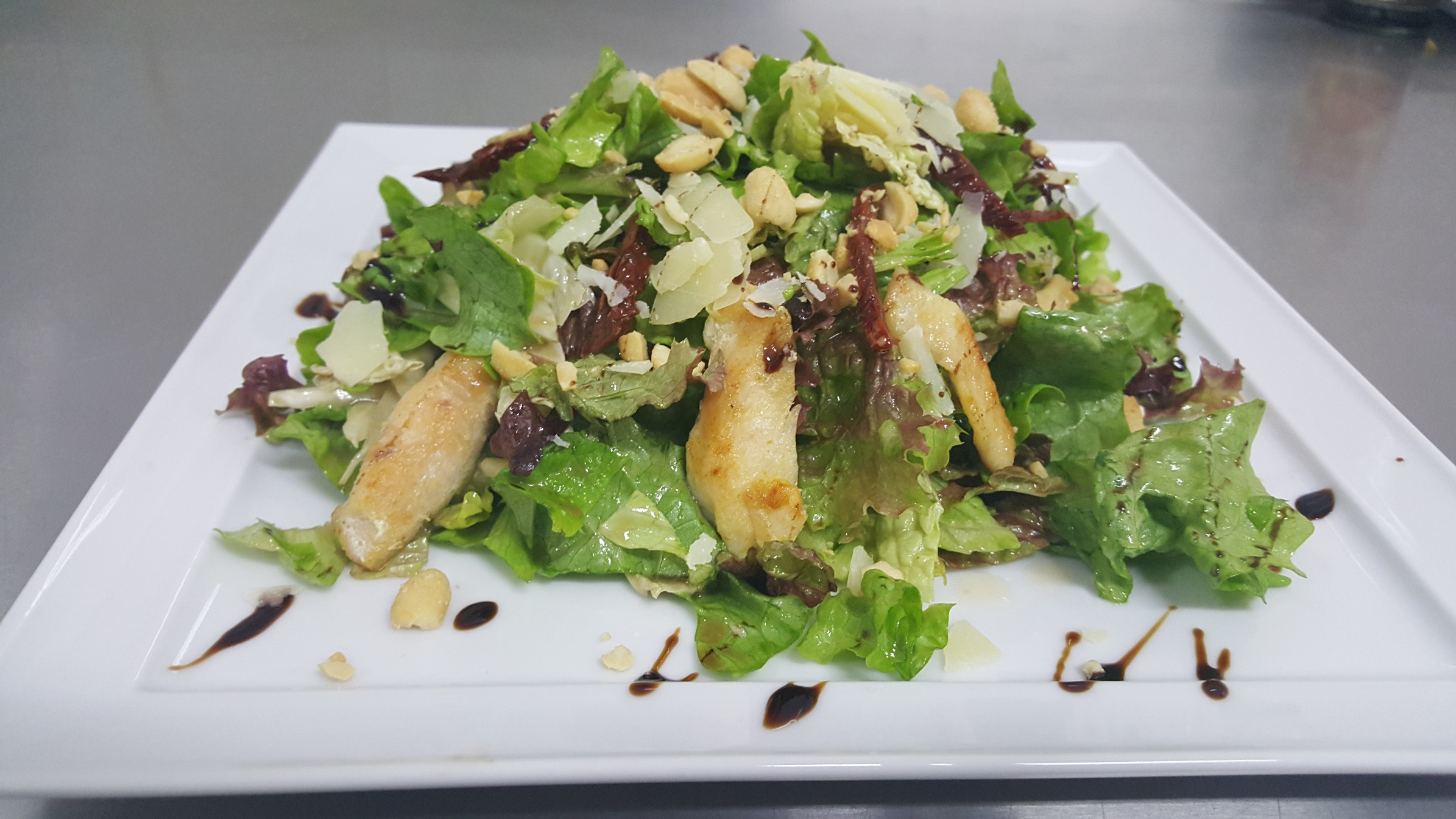 NON-ASIAN SALAD II - green and red lettuces, napa cabbage, seared chicken fillet, nuts, sun-dried tomatoes and grated parmesan, poured with honey-mustard dressing