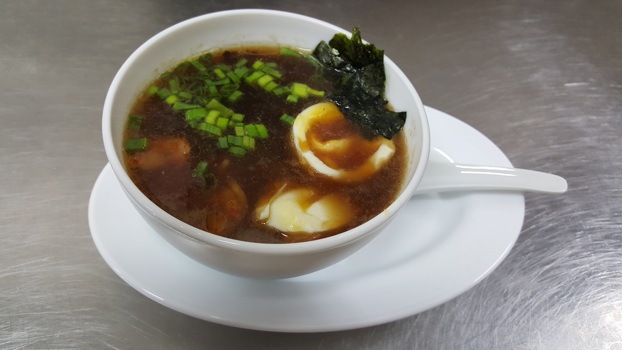 RAMEN - japanese soup with noodles, meat and fish, boiled egg and fresh onion; most popular food in Japan after sushi