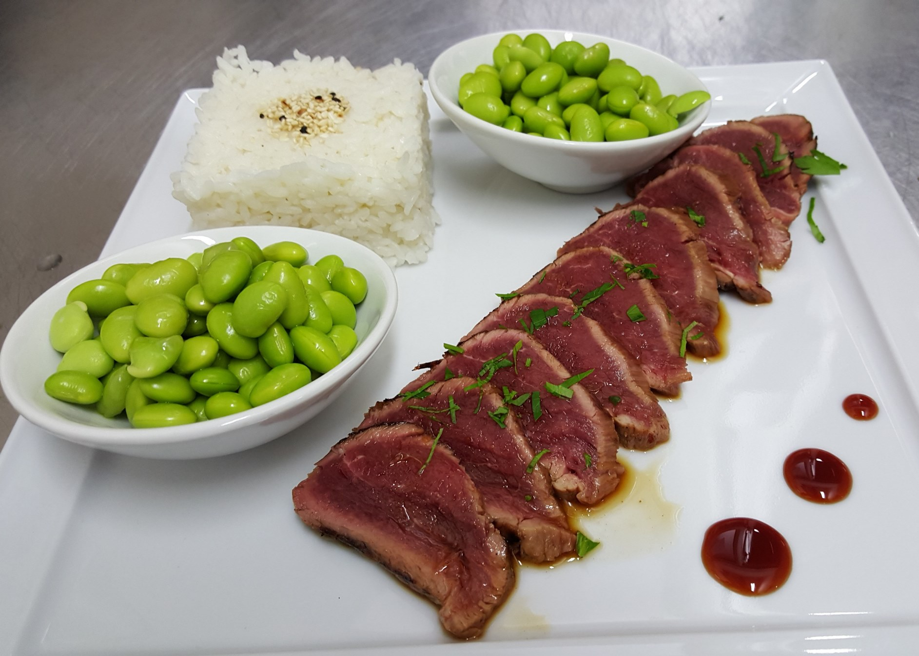 TATAKI BEEF - raw veal tenderloin, served thinly cut with Tataki sauce and mashed garlic