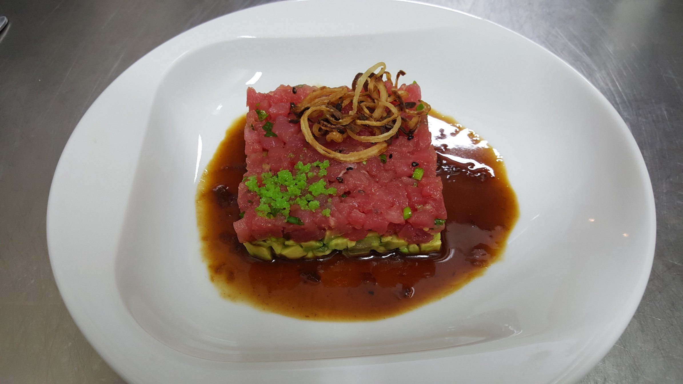TUNA TARTAR - finely cut fresh tuna cubes with avocado and spices sprinkled with crispy shallot
